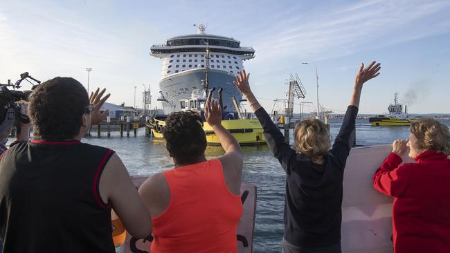 Locals gather to wave off the Ovation of the Seas cruise ship, which carried passengers who travelled to White Island when it erupted. Picture: John Boren/Getty Images.