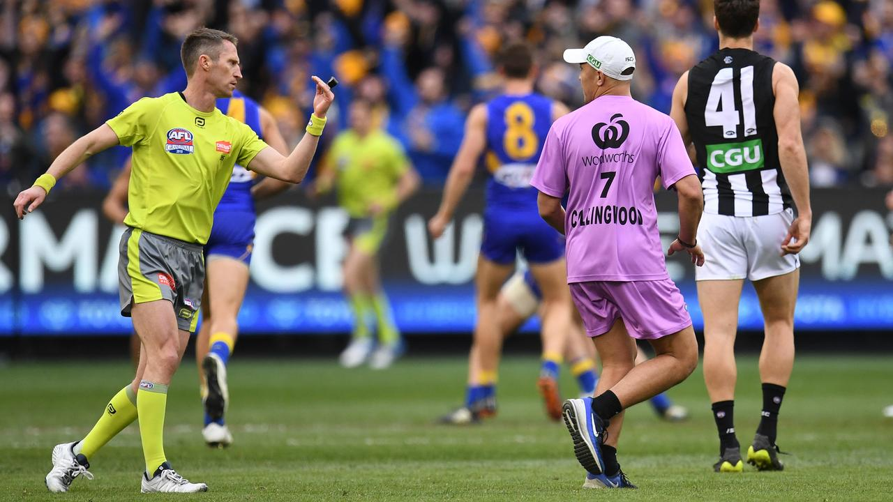 Umpire Shaun Ryan and Alex Woodward after an incident in the third quarter.