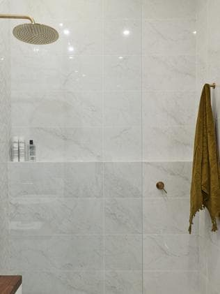 The judges loved the massive showerhead, terrazzo floors and overall tiling. Picture: The Block