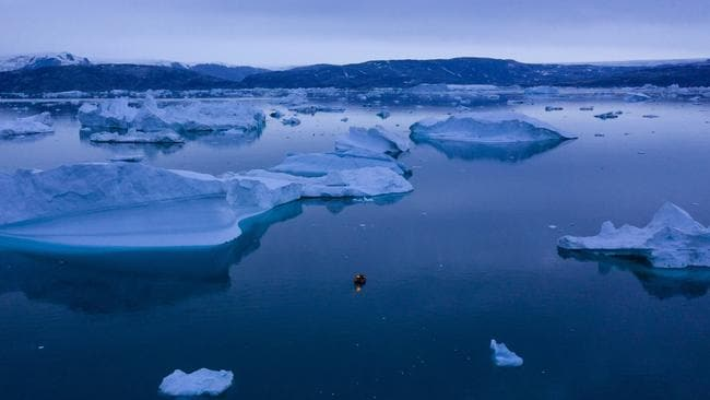 A boat navigates at night between icebergs in eastern Greenland, late Friday, August. 15, 2019. Picture: Felipe Dana/AP