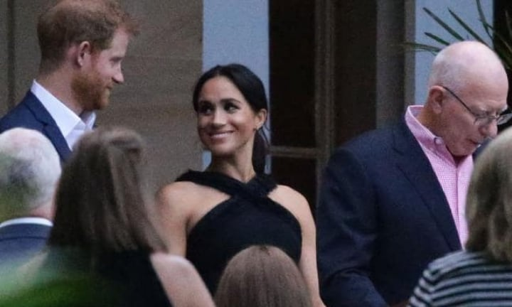 Despite her tiredness, Meghan still couldn't take her eyes off Harry. Picture: MatrixSource:Matrix