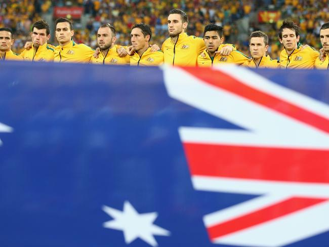 The Australian team sing the national anthem during the 2015 Asian Cup match between Oman and Australia at ANZ Stadium on January 13 this year.