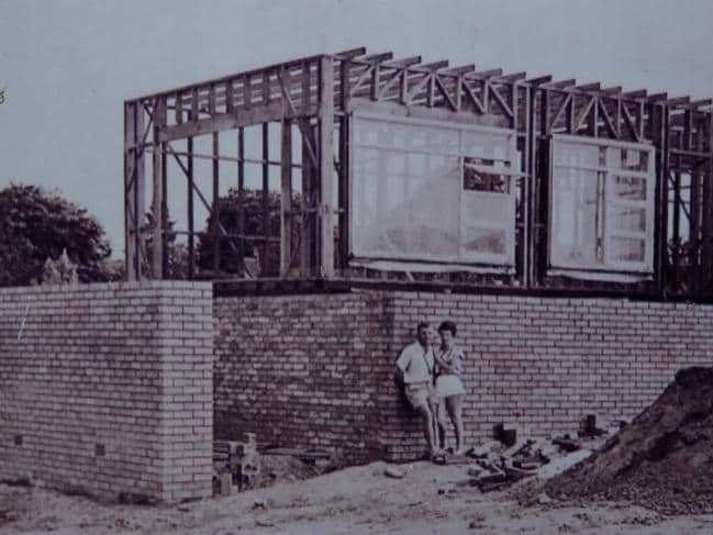 The couple outside their West Pennant Hills home when it was being built in 1959