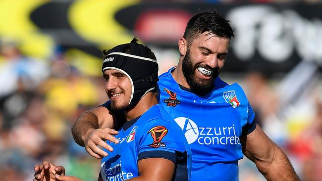 ce2e52b04b4 Joseph Tramontana (L) of Italy celebrates after scoring a try with James  Tedesco v