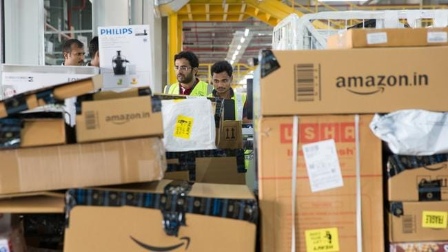 Despite the personal wealth of Amazon CEO Jeff Bezos, many employees claim they struggle to make enough money. Picture: Ruhani Kaur/Bloomberg