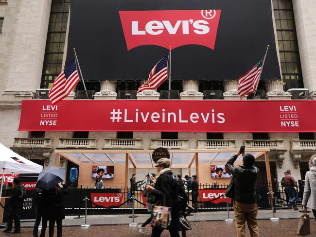 A Levi's banner hangs from the New York Stock Exchange on the day that Levi Strauss has returned to the stock market with an IPO on March 21, 2019 in New York City. Pic: AFP