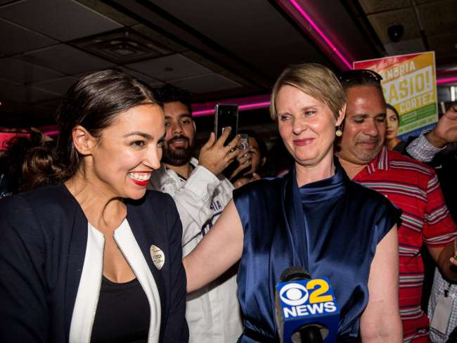 Alexandria Ocasio-Cortez is joined by New York gubernatorial candidate Cynthia Nixon at her victory party in the Bronx after upsetting incumbent Democrat Joseph Crowley. Photo: Scott Heins/Getty