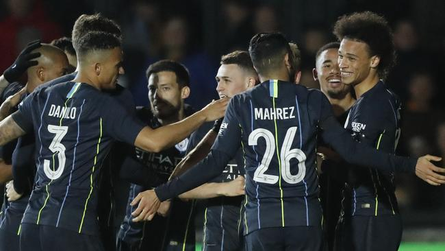 Manchester City's Leroy Sane, right, celebrates with his teammates after scoring his side's opening goal. Picture: AP