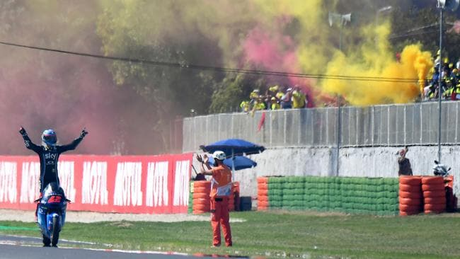 The partisan fans celebrate Bagnaia's Moto2 victory.