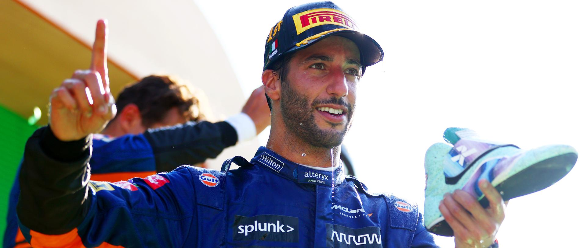 MONZA, ITALY - SEPTEMBER 12:  Daniel Ricciardo of Australia and McLaren celebrates with a shoey on the podium after winning the F1 Grand Prix of Italy at Autodromo di Monza on September 12, 2021 in Monza, Italy. (Photo by Dan Istitene - Formula 1/Formula 1 via Getty Images)
