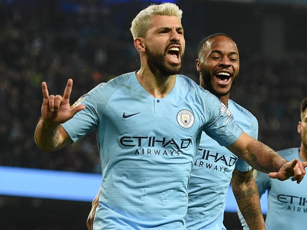 "(FILES) In this file photo taken on February 27, 2019 Manchester City's Argentinian striker Sergio Aguero (L) celebrates after scoring the opening goal from the penalty spot during the English Premier League football match between Manchester City and West Ham United at the Etihad Stadium in Manchester, north west England. - Premier League clubs will return to training in small groups from Tuesday after the latest stage of ""Project Restart"" was approved on Monday, May 18. (Photo by Oli SCARFF / AFP) / RESTRICTED TO EDITORIAL USE. No use with unauthorized audio, video, data, fixture lists, club/league logos or 'live' services. Online in-match use limited to 120 images. An additional 40 images may be used in extra time. No video emulation. Social media in-match use limited to 120 images. An additional 40 images may be used in extra time. No use in betting publications, games or single club/league/player publications. /"