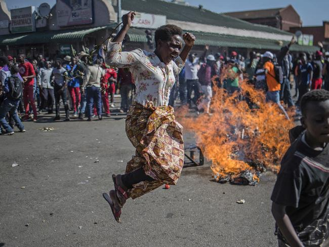 Hundreds of angry opposition supporters outside Zimbabwe's electoral commission were met by riot police firing tear gas. Picture: AP