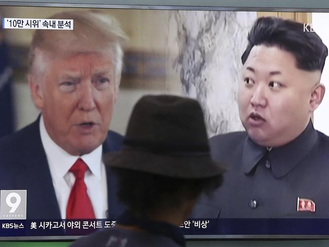 U.S. President Donald Trump and North Korean leader Kim Jong Un during a news program at the Seoul Train Station in Seoul. Picture: AP