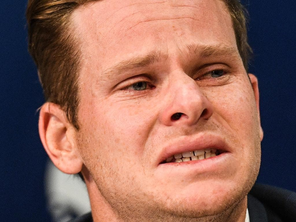 Disgraced Australian Cricket Captain Steve Smith reacts during a press conference at Sydney International Airport in Sydney, Thursday, March 29, 2018. Smith has been stood down as Australian Captain and suspended for twelve months following his involvement in the ball tampering incident which has also seen Vice Captain David Warner and opening batsman Cameron Bancroft suspended for twelve months and nine months respectively. (AAP Image/Brendan Esposito) NO ARCHIVING