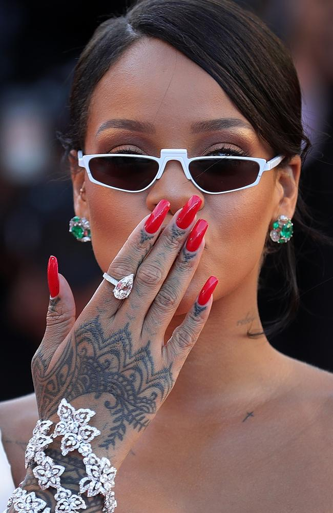 Stars including Rihanna kept wearing these small-lensed sunglasses all year and we just can't work out why.