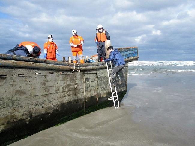 """This is one of the """"ghost boats"""" where eight bodies were found last month. Dozens of North Korean fishing vessels wash up on Japan's coast each year. Picture: AFP PHOTO / JIJI PRESS"""