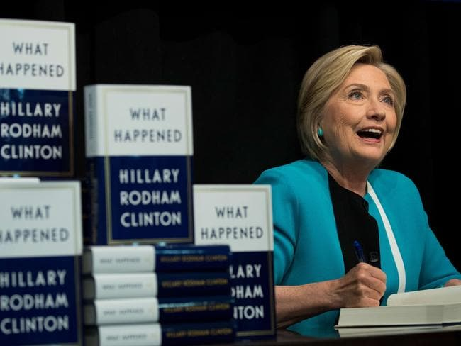 Former US secretary of state Hillary Clinton signs copies of her new book What Happened in New York City. Picture: Drew Angerer/Getty Images/AFP