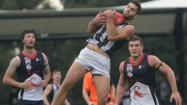 Nick Riddle takes a mark in the VFL against Casey. Picture: Susan Windmiller