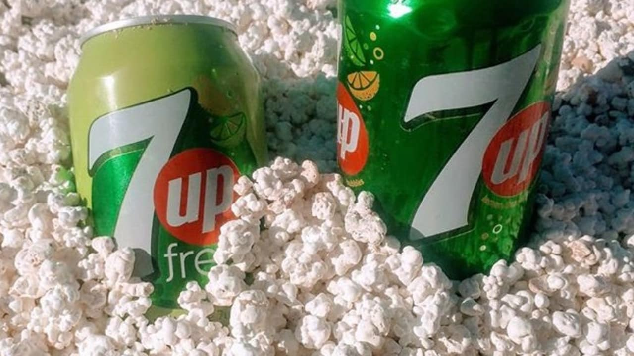 "Cans of soft drink resting in ""popcorn"" on Popcorn Beach, Canary Islands, Spain. Picture: @_irens_ /Instagram"