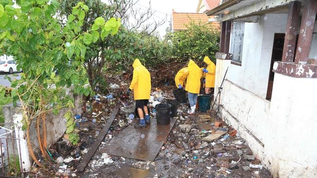Mary Bobolas's front yard after the clean-up removed tonnes of rubbish. Picture: Adam Taylor