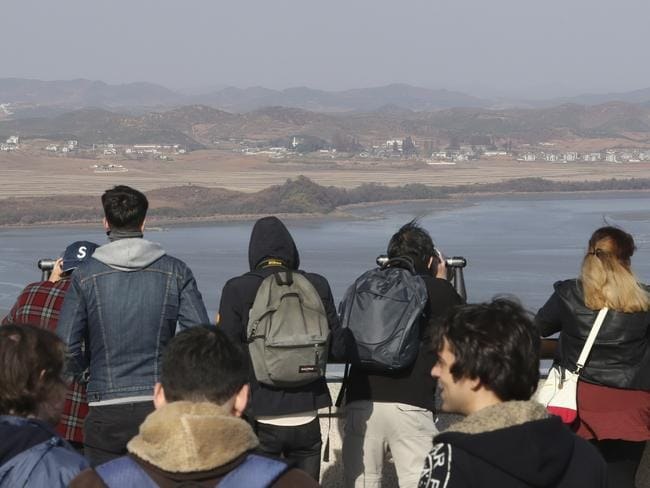 Tourists look across to North Korea from a South Korean observatory. Picture: AP/Lee Jin-man