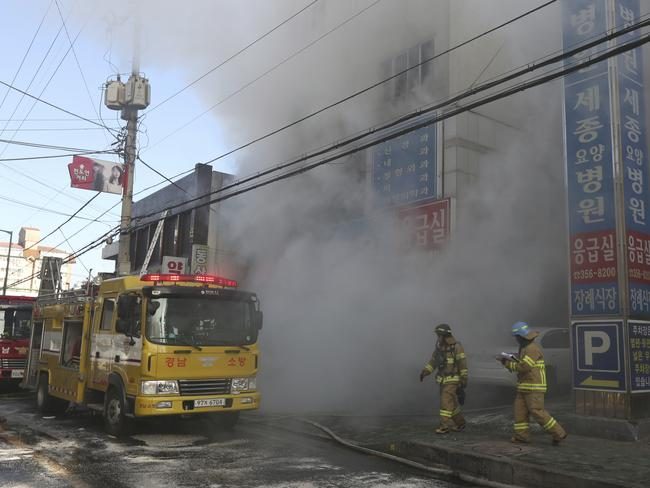 Firefighters battled to contain the fatal blaze. Picture: AP