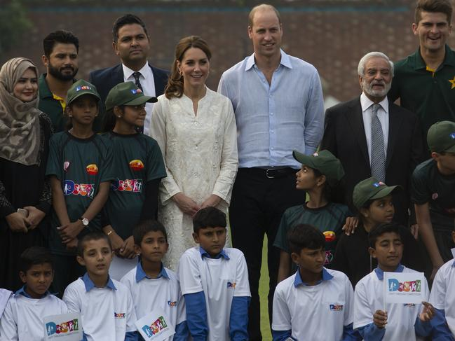 Prince William and his wife Kate, Duchess of Cambridge pose with Pakistani students during their visit at the Pakistan Cricket Academy. Picture: AP Photo/B.K. Bangash