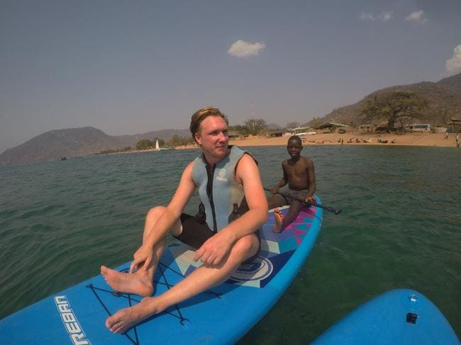 James on a canoe on the Malawi River, where he contracted schistosomiasis. Picture: SWNS / Mega