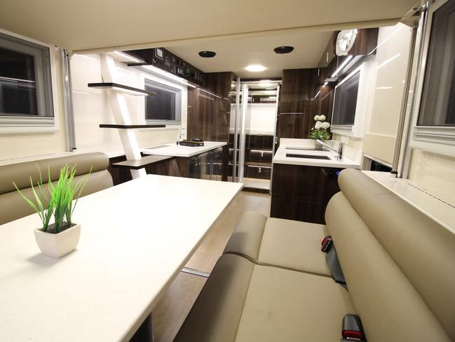 The kitchen and dining area is spread out on the bottom level, while upstairs there are six beds. Picture: SLRV Expedition Vehicles