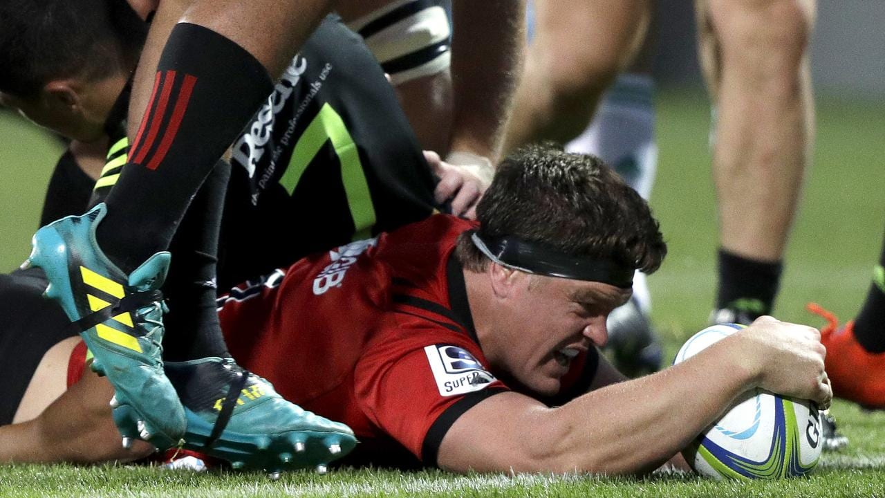 Crusaders lock Scott Barrett reacts after scoring his second try in Christchurch.