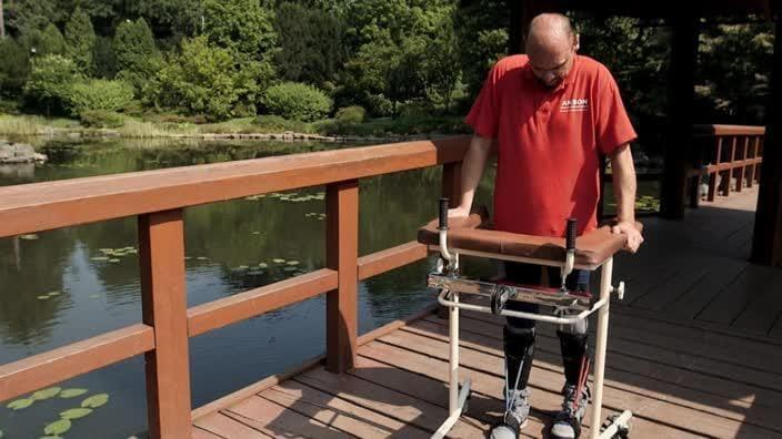 Paralysed man walks again