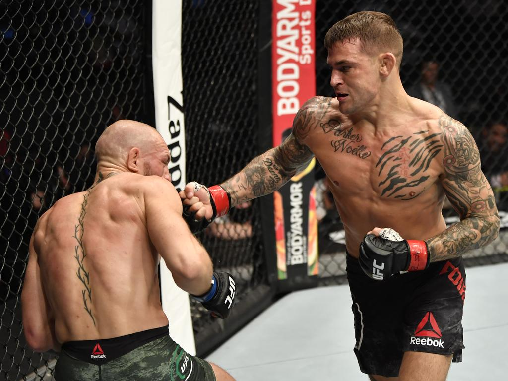 Dustin Poirier punches Conor McGregor. Photo: UFC supplied image.