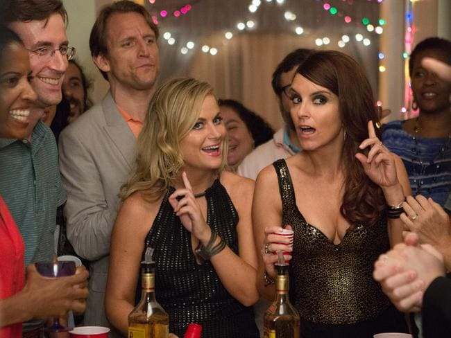 Amy Poehler, left, and Tina Fey appear in a scene from the film, 'Sisters'. Picture: KC Bailey/Universal Pictures via AP