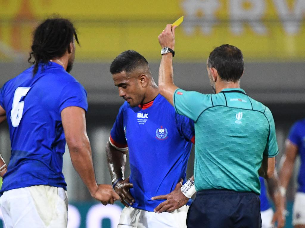 Samoa's centre Rey Lee-Lo (C) receives a yellow card from French referee Romain Poite (R) during the Japan 2019 Rugby World Cup Pool A match between Russia and Samoa at the Kumagaya Rugby Stadium in Kumagaya on September 24, 2019. (Photo by William WEST / AFP)