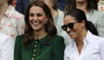 Kate, Duchess of Cambridge and Meghan, Duchess of Sussex, right, stand together during the women's singles final match on day twelve of the Wimbledon Tennis Championships in London, Saturday, July 13, 2019. (AP Photo/Ben Curtis)