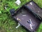 A suitcase found in the wreckage. Picture: AFP