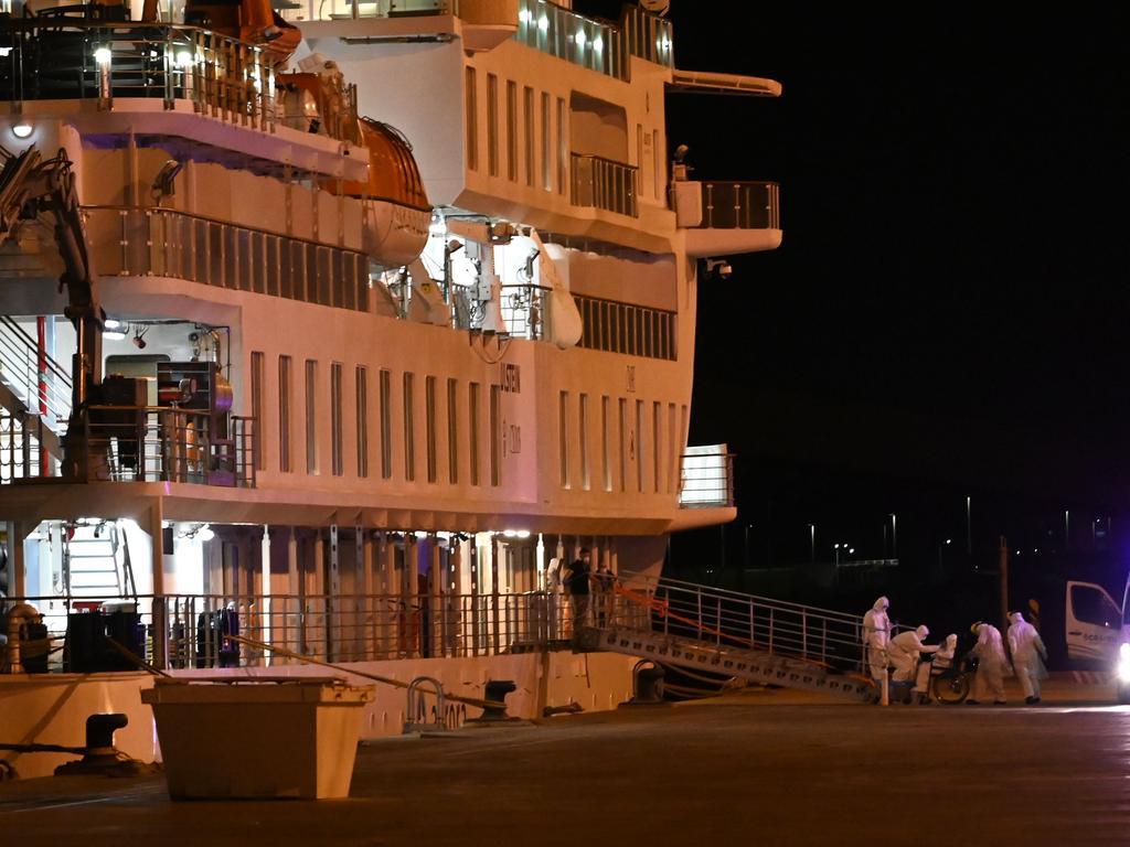 Australian liner passengers affected by COVID-19 coronavirus Greg Mortimer disembarked using cruise ship personal protective equipment. Image: AFP