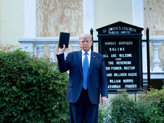 President Trump holds a bible while visiting St. John's Church across from the White House after the area was cleared of protesters. Picture: Brendan Smialowski/AFP