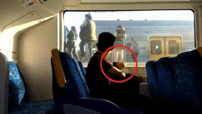 Samuel Tjin allegedly holds up his phone (circled) to the train window as girls wait on the platform. Picture: ACA.