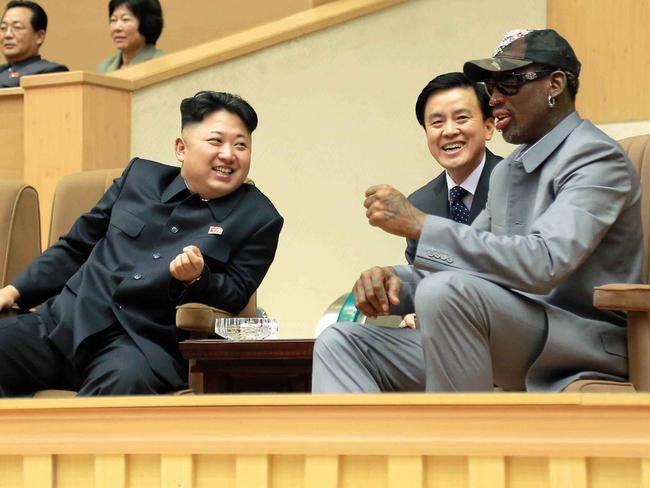 Dennis Rodman (right) watches a basketball game with North Korean leader Kim Jong-un (left) in Pyongyang in 2014. Picture: Korean Central News Agency/Korea News Service via AP
