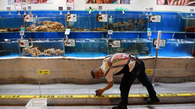 China, and the world's, huge appetite for seafood is part of the reason the oceans are being so aggressively fished. Picture: GREG BAKER/ AFP