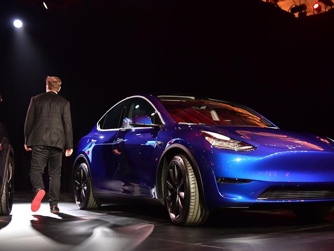 Tesla CEO Elon Musk walks past a new Tesla Model Y at its unveiling in Hawthorne, California. Picture: AFP