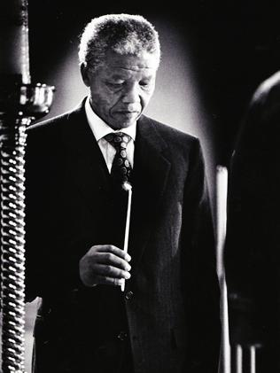 Nelson Mandela at a St Marys Cathedral mass in Sydney. Picture: News Ltd