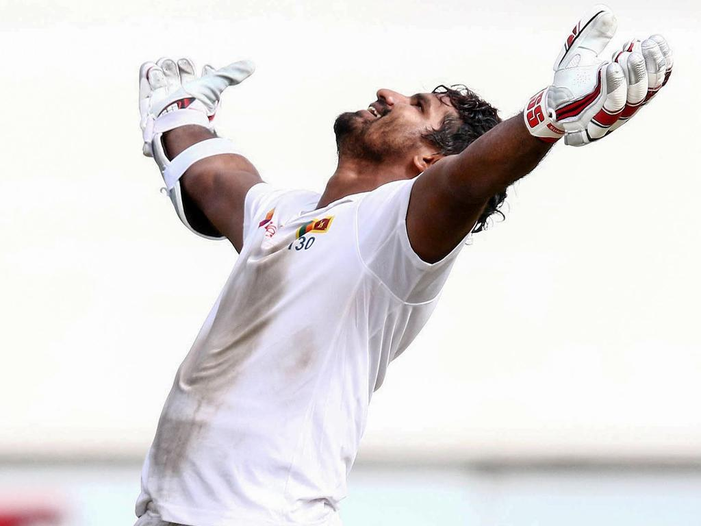 Sri Lanka's Kusal Perera celebrates the win during the fourth day of the first Cricket Test between South Africa and Sri Lanka at the Kingsmead Stadium in Durban on February 16, 2019. (Photo by Anesh DEBIKY / AFP)