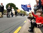 Alyce, 3, at the Anzac Day memorial parade, Adelaide. Picture: Tricia Watkinson