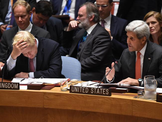 Awkward! UK Foreign Secretary Boris Johnson sits next to US Secretary of State John Kerry during the heated exchange.