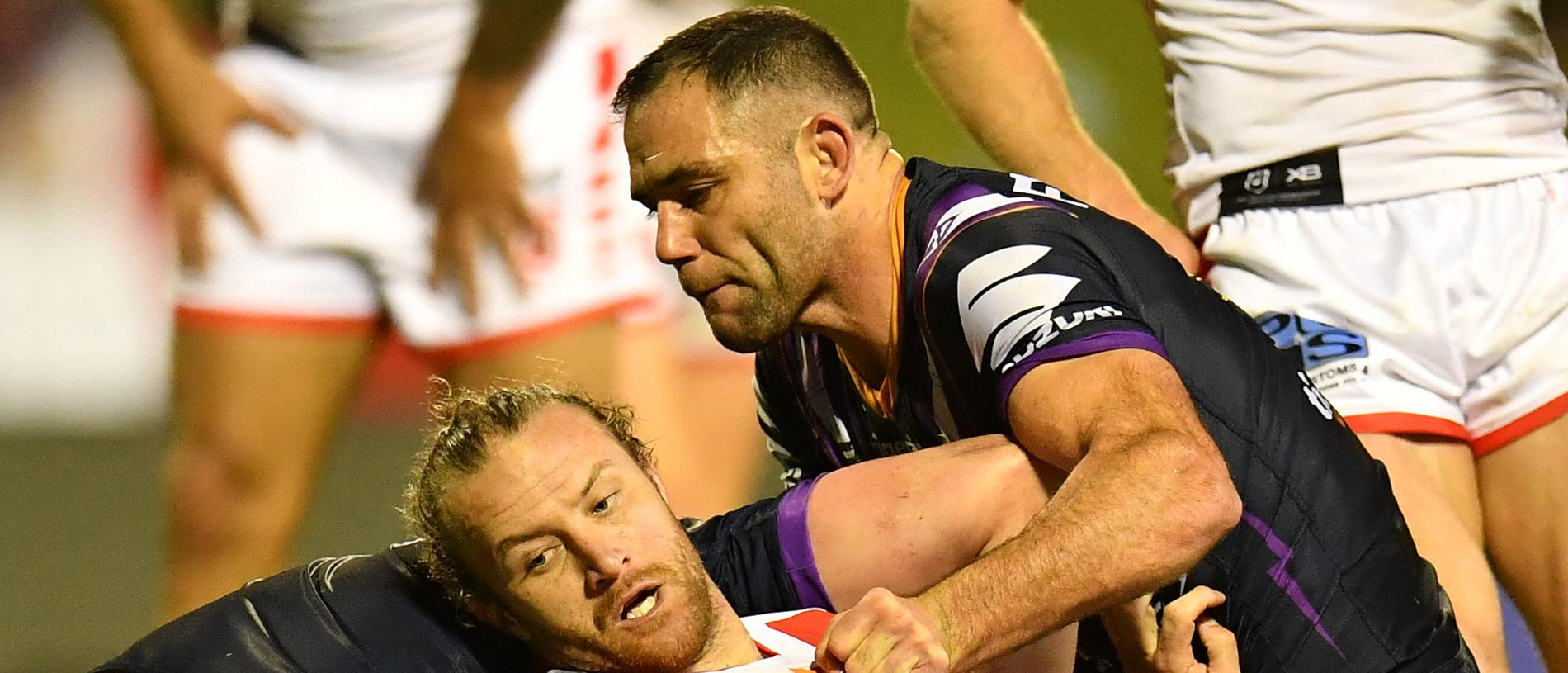Korbin Sims of the Dragons is tackled by Cameron Smith of the Storm during the Round 16 NRL match between the St George Illawarra Dragons and Melbourne Storm at WIN Stadium in Wollongong, Thursday, July 4, 2019. (AAP Image/Dean Lewins) NO ARCHIVING, EDITORIAL USE ONLY