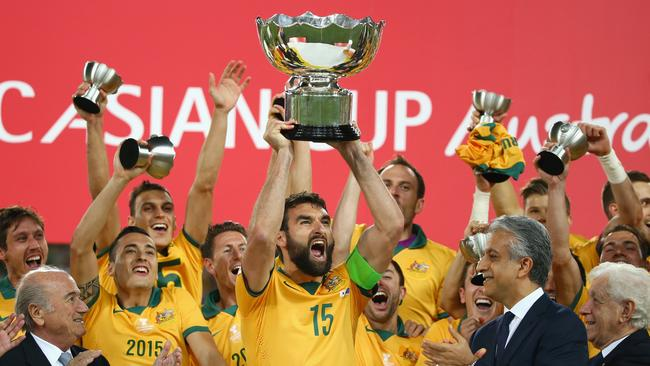 Mile Jedinak of Australia and his team celebrate as he lifts the Asian Cup trophy.
