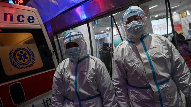 Medical staff members wearing protective clothing to help stop the spread of the deadly COVID-19 coronavirus which began in the city, walking at the Wuhan Red Cross Hospital in Wuhan.