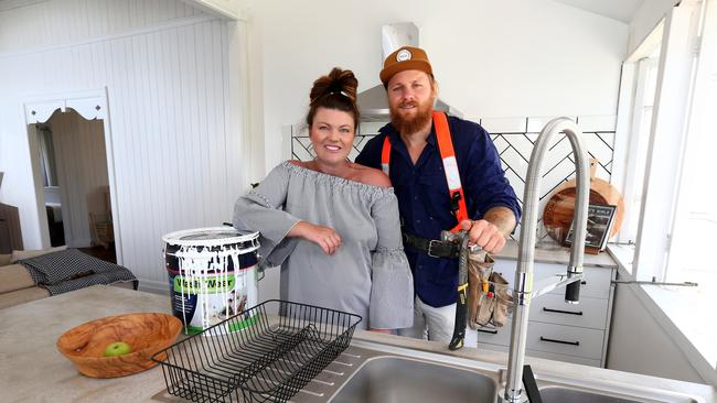Chris and Tiffany Campbell have owned a number of homes across Brisbane's affordable havens. They have renovated them and sold for a profit. Picture: AAP/David Clark.